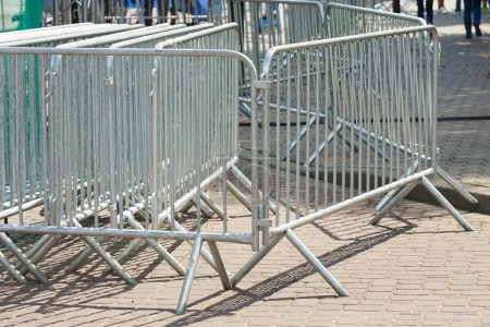 Photo for Metal barriers separating people at the concert, grouped into deployment. - Royalty Free Image