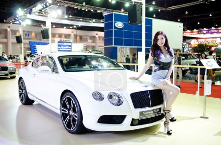 Photo for BANGKOK - MARCH 29 : Unidentified model with BENTLEY Continental GT V8 on display at Bangkok International Motor Show 2014 on March 29, 2014 in Bangkok, Thailand. - Royalty Free Image