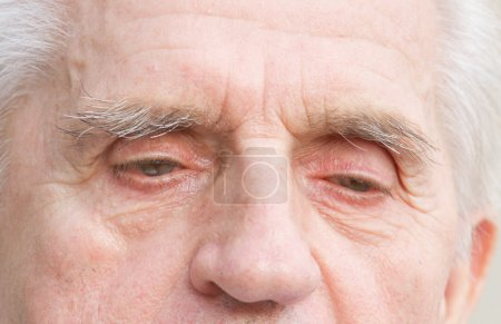 Photo for Close up of old man pensive eyes - Royalty Free Image