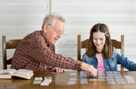 Photo for Grandpa and granddaughter playing memory game with cards - Royalty Free Image