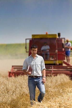 Attractive man at harvesting
