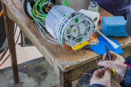 Fibre optic technician preparing the fibers 2