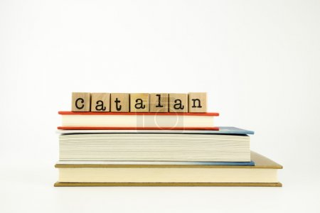 Catalan language word on wood stamps and books