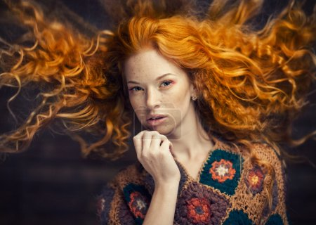 Photo for Red-haired girl with flying hair - Royalty Free Image