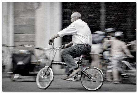 Man ridding a bicycle in Italy, Lucca