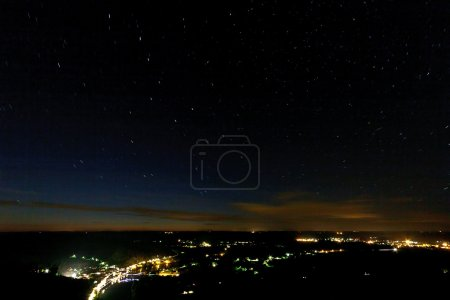Photo for Top view of city at night with stars and line of sunset on horizon. - Royalty Free Image