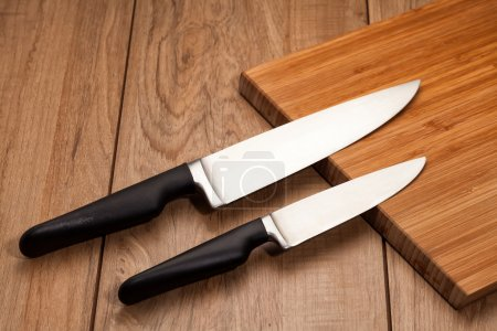 Kitchen knives on wood