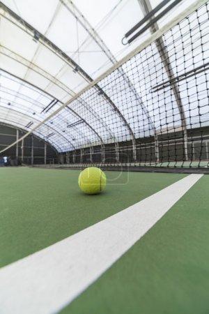 Tennis ball in indoor tennis court