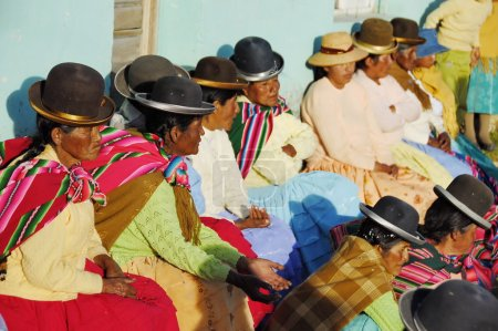 Elderly Aymara women watch traditional dance at the annual festival Morenada on Isla del Sol, Lake Titicaca, Bolivia.