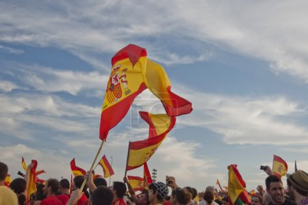 Spanish flags flutter above a stadium in Valencia, Spain.