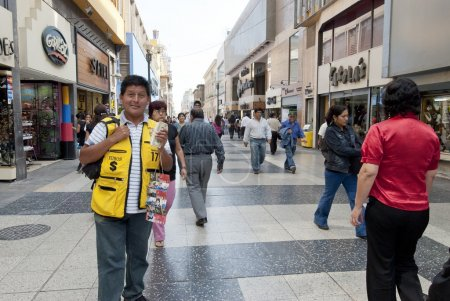Peruvian man offers exchange foreign currency on a street in Lima, Peru.