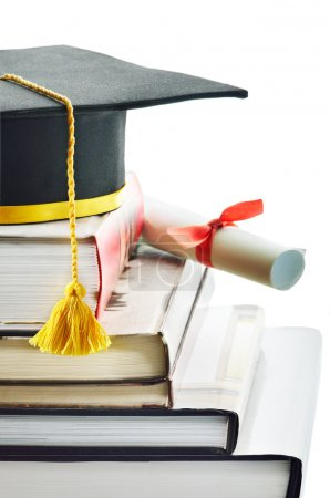 Photo for Graduation cap and diploma on top of stack of books - Royalty Free Image