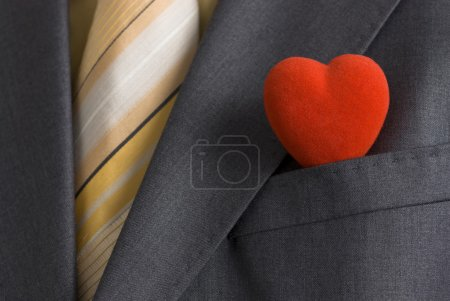 Photo for A red heart in a suit pocket representing the business card of modern Mr. Valentine. - Royalty Free Image