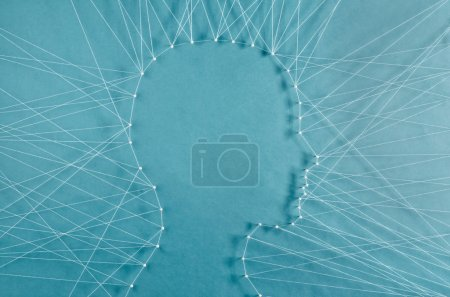 Photo for The head of a man connected to exterior by threads - Royalty Free Image