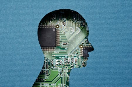 Photo for Cardboard human head cutout revealing circuit board content - Royalty Free Image
