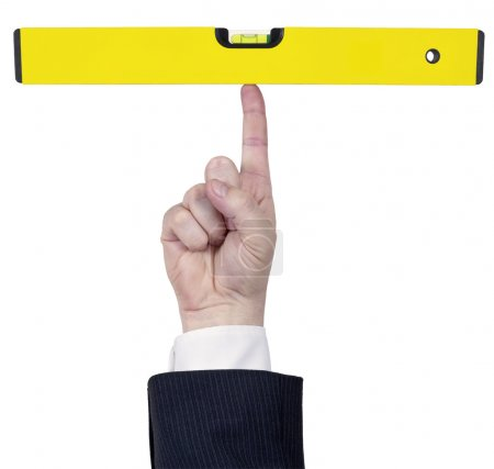 Photo for Isolated human finger hold a perfect large yellow water level - Royalty Free Image