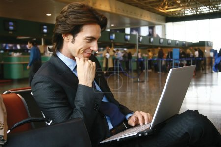 working on laptop at airport