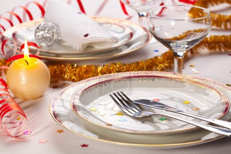 Christmas place setting with ribbon and New Year decorations