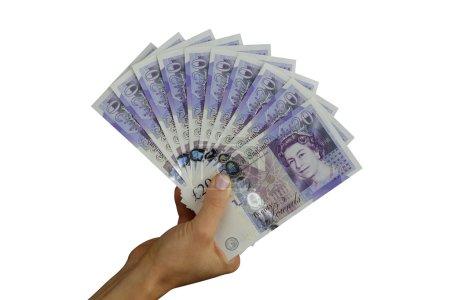Photo pour Livres sterling argent sterling à la main - image libre de droit