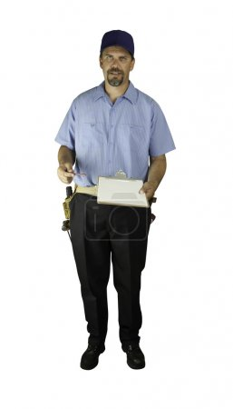 Service man standing with clipboard