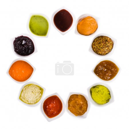 Eleven different sauces in a white bowls on the ho...