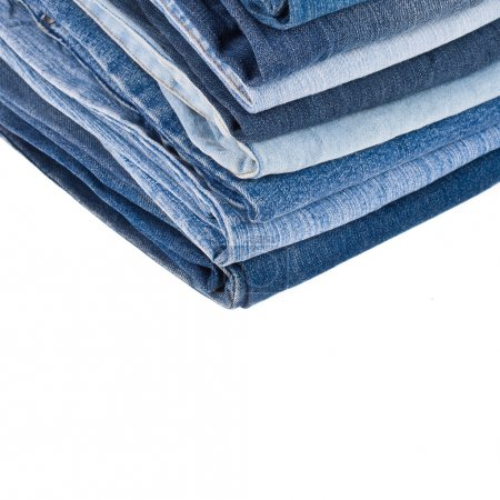 Lot of different blue jeans in the stack