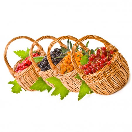 Wicker baskets with various fresh berries