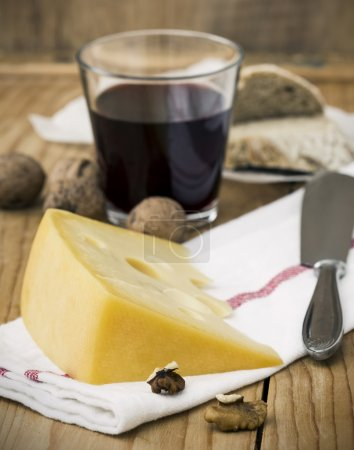 Cheese with Breads, Nuts and Wine on Table