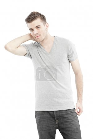 Casual man posing with his blank gray t-shirt isolated on white background