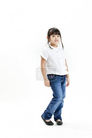 Little girl portrait with white shirt and blue jeans on the white background