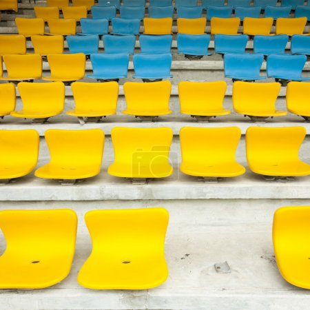 Photo for Yellow and Blue Seat on stadium - Royalty Free Image