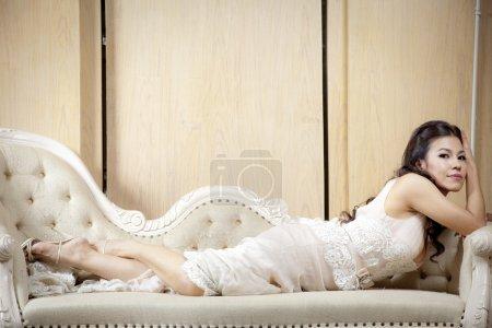 Slender woman in vintage white dress