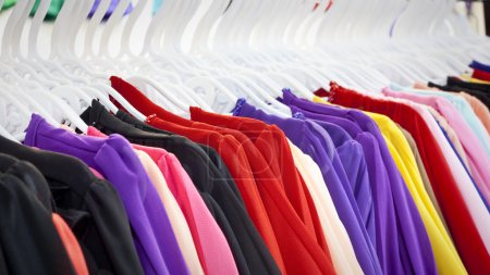 Photo for Choice of fashion clothes of different colors on hangers - Royalty Free Image