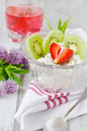 Curd dessert with fruit and fruit juice on the tab...