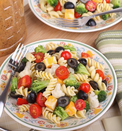 Photo for Pasta salad with tomato, broccoli, black olives, cauliflower and cheese - Royalty Free Image