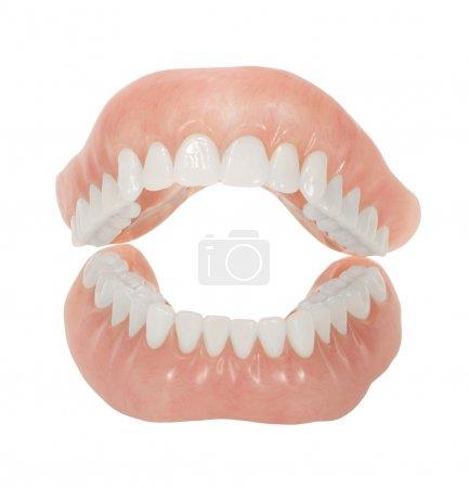 Photo pour Dentiers avec dents brillantes et bouche ouverte isolés sur blanc - image libre de droit