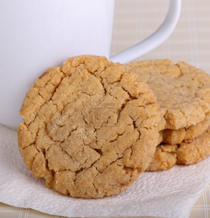 Photo for Peanut butter cookies and coffee cup on a napkin - Royalty Free Image