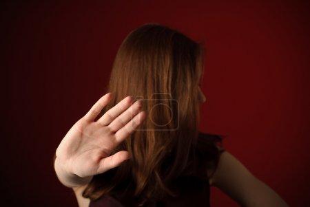 Girl signaling to stop