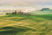 Tuscan house in the hills among the cypresses