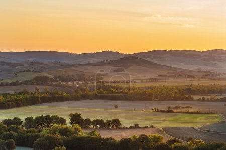 The rising sun over the Tuscan fields