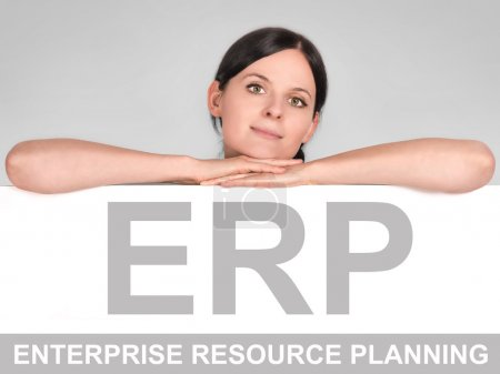 Photo for Woman leaning over a board with a ERP icon - Royalty Free Image
