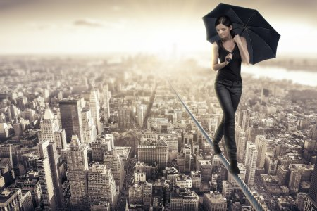 Photo for Woman walking on a rope over new york - Royalty Free Image