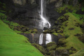 Waterfall and green hills