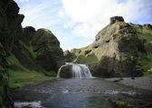 View up to Stjornarfoss waterfall