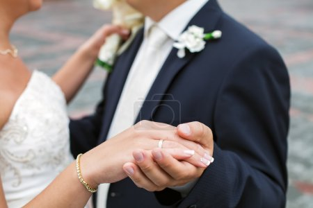 Photo for Wedding photograph of a young couple of lovers who are just married, are close to each other in harmony, love and happiness. Groom holds the bride's hand in his hand. Dancing - Royalty Free Image