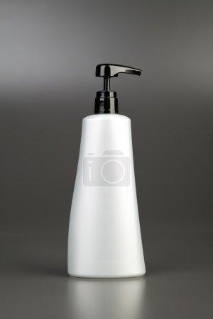 Plastic bottle on grey