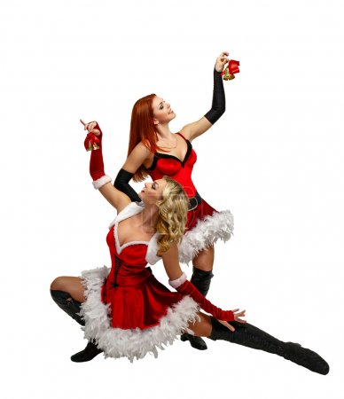 Photo pour Jeunes femmes séduisantes en costumes de carnaval et cloches de Noël isolées sur fond blanc - image libre de droit
