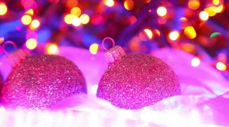 Beautiful Christmas decoration, colorful balls on defocused lights background