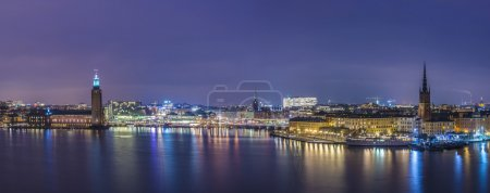 Photo for Panoramic night view over Stockholm, Sweden City Hall and historical Riddarholmen. - Royalty Free Image