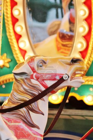 Vintage carousel merry-go-round painted horses - Stock Photo